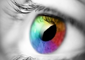 Black and White picture with a multi-colored eye